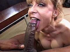 Mature sucks n jumps on black dick