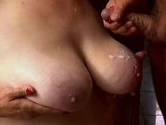Chesty granny gets cumload on boobs