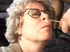Granny in glasses gets cum on face