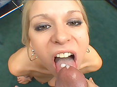 Fine blonde babe Erin Moore sucking a massive dick on film
