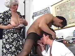 Two grannies share cock